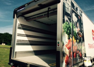 Transgourmet vehicle with air curtain installed under shutter door