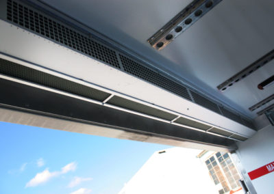 Air curtain BlueSeal drawing inside air in refrigerated vehicle